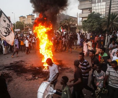 African Union suspends Sudan; World Bank pauses funds over coup