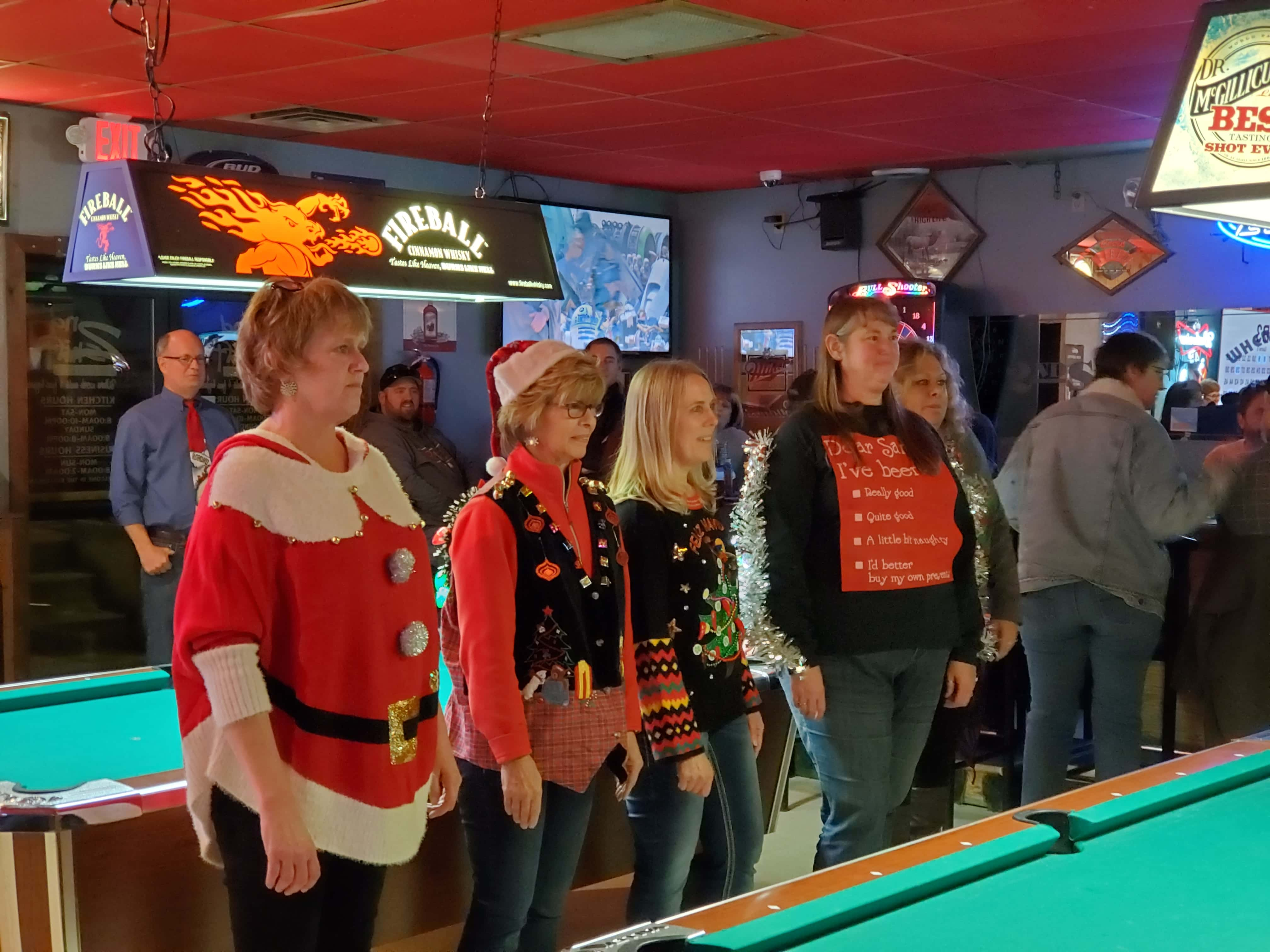 The Contestants for the Ugly Christmas Sweater Contest