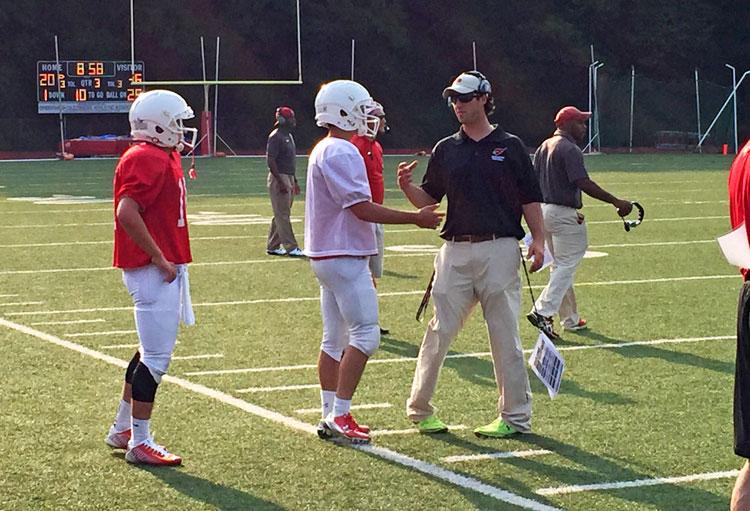 Greenwich High School head coach John Marinelli talks to his team during the Red & White scrimmage at Cardinal Stadium. (Paul Silverfarb photo)