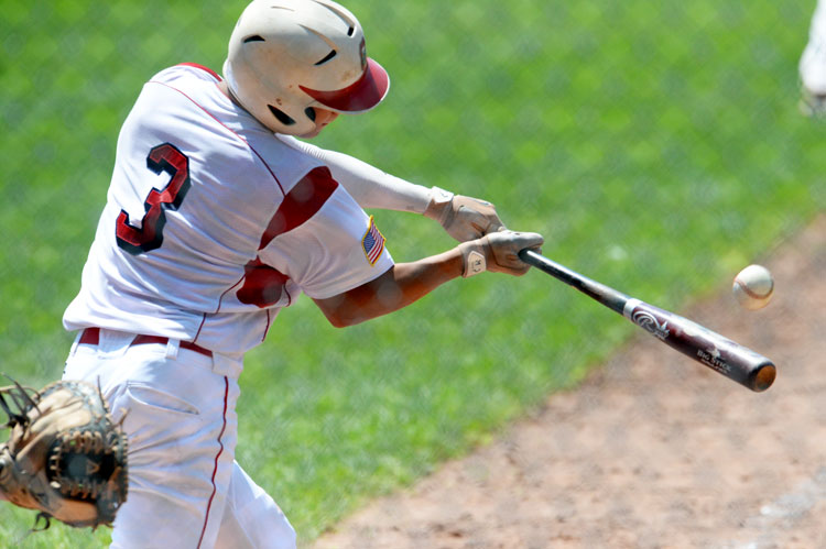 Greenwich's Alex Loparco swings at a pitch in a recent Senior Legion game. (John Ferris Robben photo)
