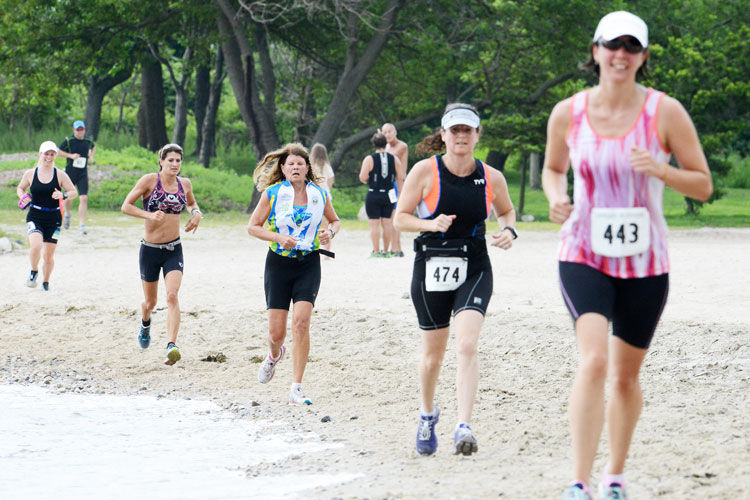 Racers compete in the running portion of the triathlon during Sunday's 31st annual Grenwich Cup Triathlon at Tod's point. (John Ferris Robben photo)