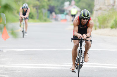 Athletes at the Grenwich Cup Triathlon, sponsored by Threads & Treads, take to the streets for the bike portion of the Sunday morning event. (John Ferris Robben photo)