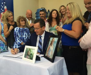 "Gov. Dan Malloy signs ""Emily's Law"" in Stamford on Friday, September 18"
