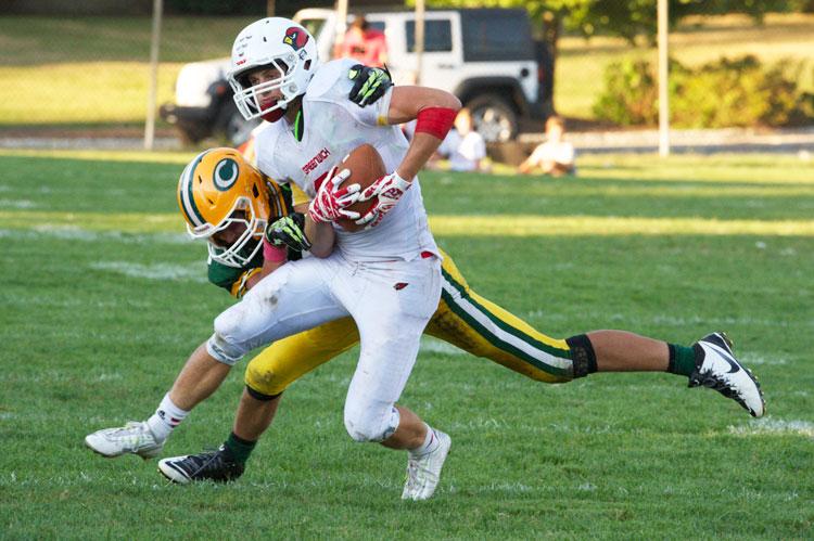 The Greenwich High School football team opened its season with a tough 42-38 victory against Trinity Catholic High School. (John Ferris Robben photo)