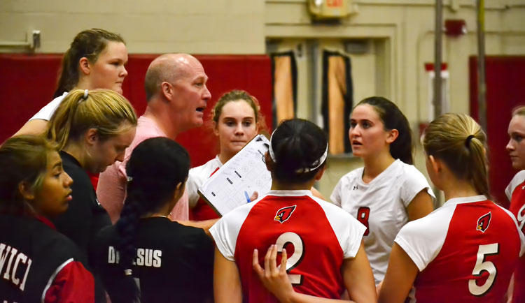Greenwich High School head coach Steve Lapham instructs his volleyball team during a timeout in Tuesday's match against Fairfield Warde High School. (Paul Silverfarb photo)