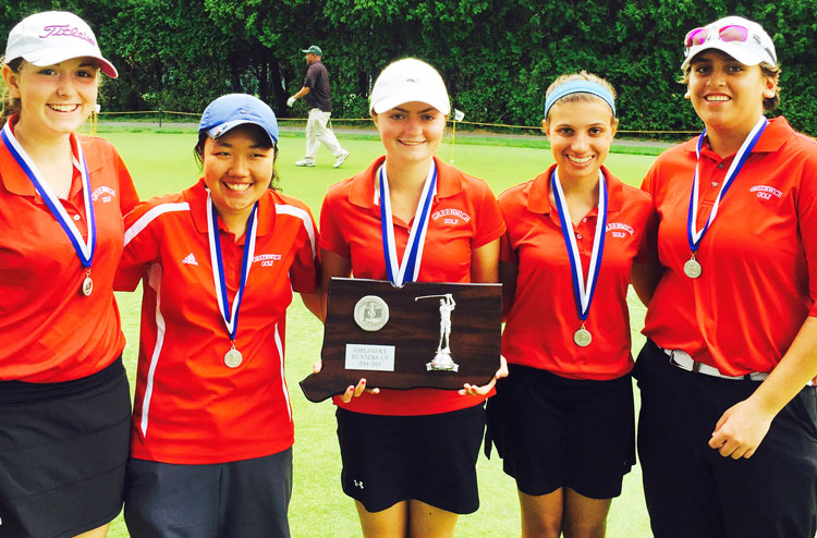 Greenwich High School senior Catherine McEvoy, center, holds the state runner-up trophy during last year's tournament. McEvoy will be honored by the Fairfield County Sports Commission as the Town of Greenwich Athlete of the Year.