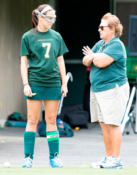 Legendary former Greenwich Academy lacrosse and field hockey head coach, as well as former athletic director Angela Tammaro talks to one of her captains. Tammaro is being honored Monday night at the Fairfield County Sports Commission Sports Night.  (photo courtesy of the Fairfield County Sports Commission)