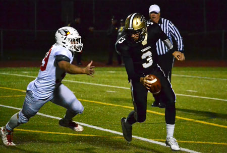 The Greenwich High defense was able to keep Trumbull quarterback John McElroy off-balance throughout much of the second half. (Paul Silverfarb photo)