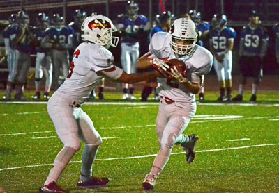 Greenwich's Kevin Iobbi gets the handoff during Friday's game against Fairfield Ludlowe. (Paul Silverfarb photo)