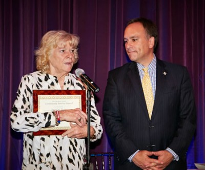 First Selectman Peter Tesei with Kerrin Coyle holding the Barbara Nolan Community Service Award given posthumusly to her longtime companion Selectman David Theis. Photo by Elaine Ubiña