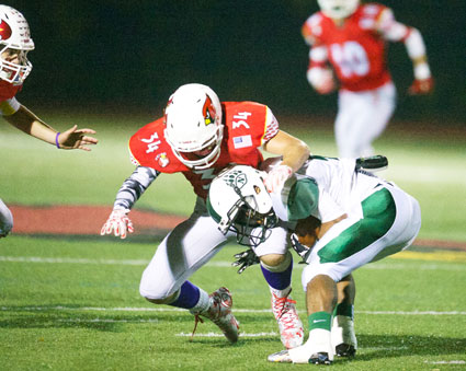 Greenwich's Michael Gianesello applies the tackle during Friday's game under the lights at GHS. (John Ferris Robben photo)