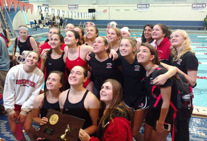 Posing for a team photo for the parents sitting above the pool in the stands, the Greenwich High School girls swimming and diving team show off their state title trophy. (Paul Silverfarb photo)