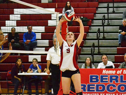 Greenwich High sophomore Maggy Egan sets the ball for Abbie Wolf during the first set of Saturday night's game against Fairfield Ludlowe High School. (Paul Silverfarb photo)