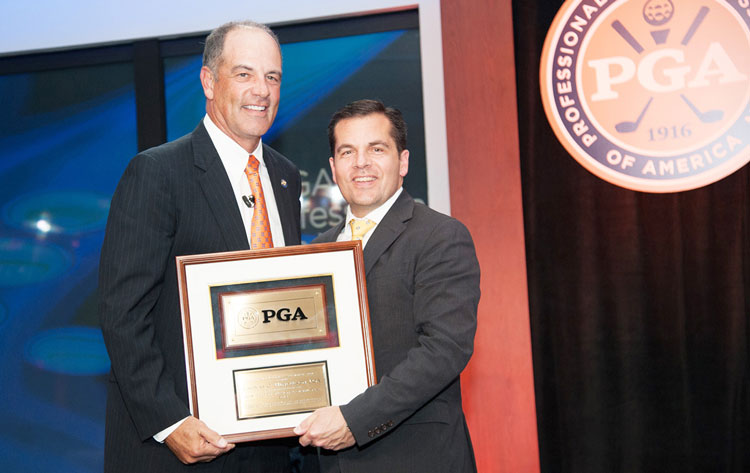 PGA of America President Derek Sprague, right, presents the PGA Golf Professional of the Year to Round Hill Country Club Professional Tom Henderson during the 2015 PGA of America National Awards at the 99th PGA Annual Meeting. (photo courtesy of Montana Pritchard/The PGA of America)