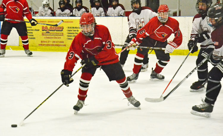 Greenwich High School's Owen Johnson works the puck towards the Milford Co-Op net during Saturday's scrimmage. Greenwich starts its season tonight at 6 when they travel to Middletown and play Xavier. (Paul Silverfarb photo)