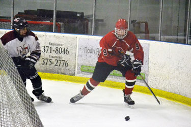 Ollie Fulton gets behind the Milford net during Saturday's scrimmage. (Paul Silverfarb photo)