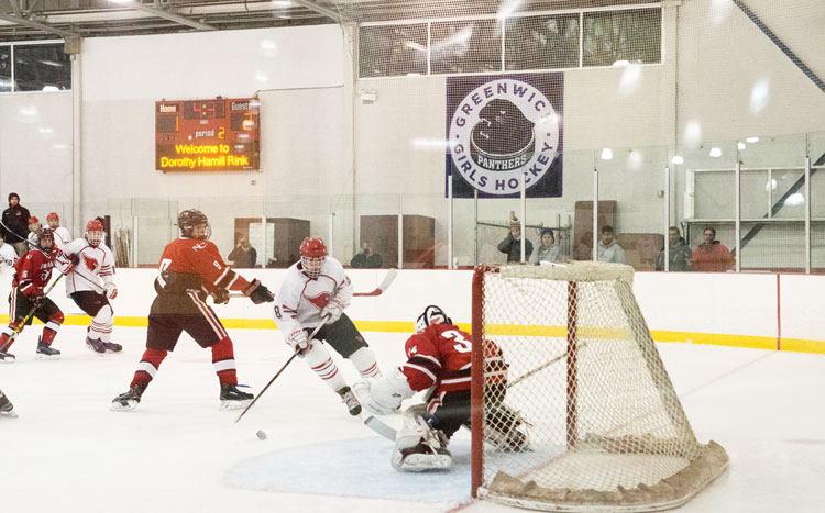 Greenwich High School's Mike Mozian skates in for a goal during Monday's game against New Canaan. (John Ferris Robben photo)