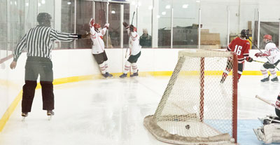 Big Red celebrates one of its six goals during Monday's game against the Rams. (John Ferris Robben photo)