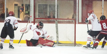 GHS goalie Nick Bozzuto makes one of his 25 saves on the day during Monday's game against FCIAC foe New Canaan. (John Ferris Robben photo)