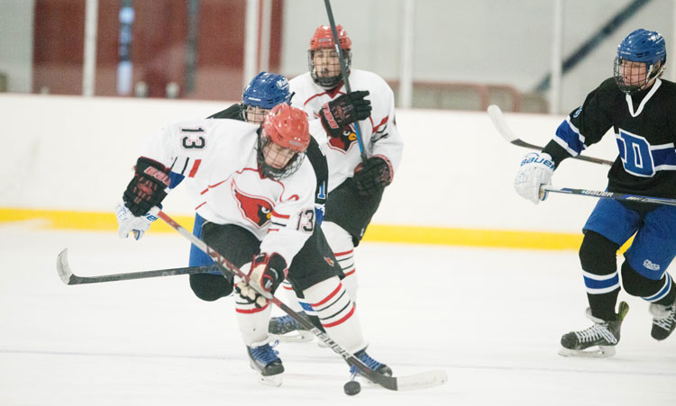 Greenwich High School's KC Cunningham darts past the Darien defense during Monday night's game at the Dorothy Hamill Ice Rink. (John Ferris Robben photo)