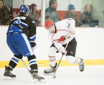 Big Red's Alex Mozian competes against Darien High School during Monday's game at the Dorothy Hamill Ice Rink. (John Ferris Robben photo)