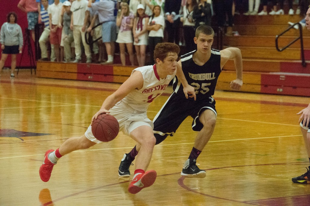 Henry Golden drives by a Trumbull High defender in Tuesday's 69-64 win. (John Ferris Robben Photo)