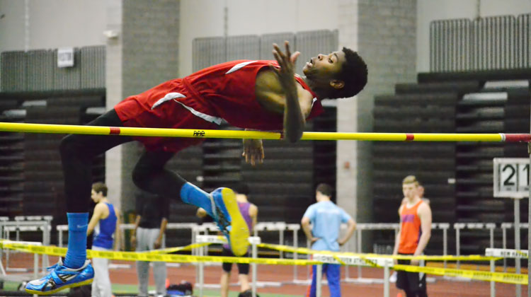 Greenwich High junior Safir Scott just cleared 6-04, tied a school record and won FCIAC gold. (Paul Silverfarb photo)