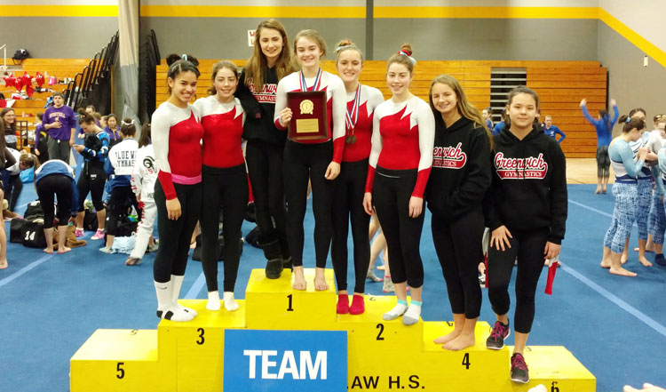 The Greenwich High School gymnastics team poses for a team photo after claiming the FCIAC gymnastics championship Saturday afternoon at Jonathan Law High School in Milford. (Paul Silverfarb photo)