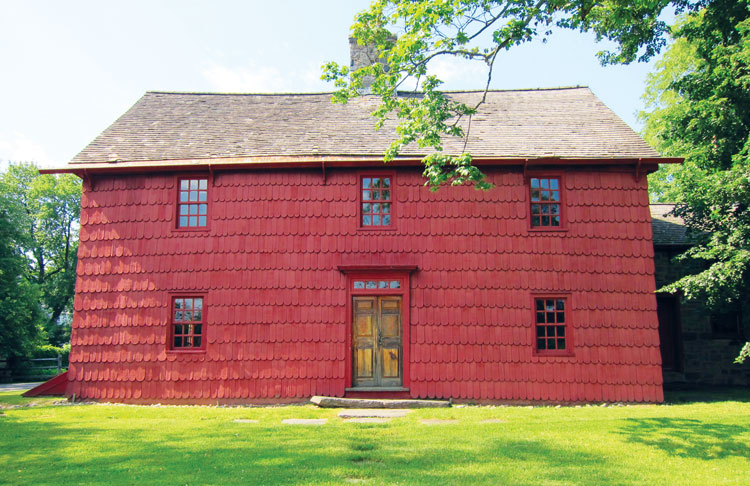 This bright red house located on the north side of East Putnam Avenue in central Greenwich has a long and colorful history.
