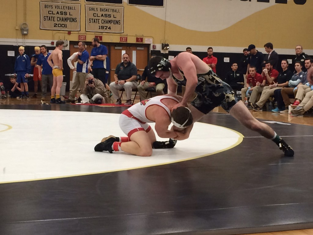 Mike Ceci attempts to take down Joey Ryan of Trumbull in the 160-pound finals.