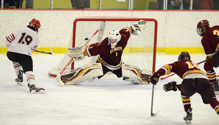 Greenwich High School's Mike Mozian beats the St. Joseph defense and eludes the goalie to find the back of the net in the FCIAC championship game Saturday at the Terry Conners Rink. (John Ferris Robben photo)