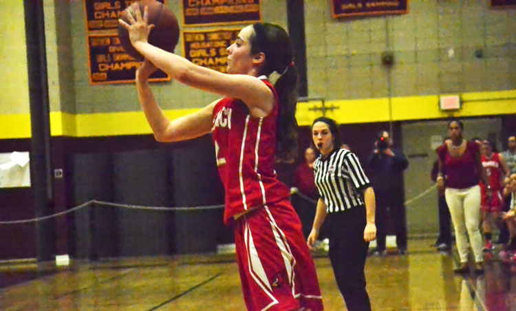 Greenwich High School senior co-captain Caroline Beneville hits one of her three-pointers during Friday night's CIAC class LL semifinal game against E.O. Smith. (Paul SIlverfarb photo)
