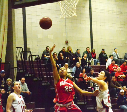 Greenwich High junior Jayla Faison goes hard to the basket during Friday night's CIAC class LL semifinal win against E.O. Smith. (Paul Silverfarb photo