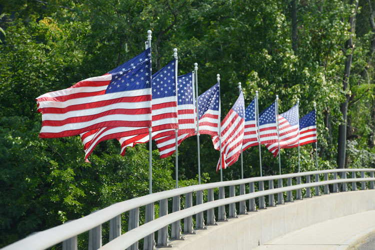 American flags fly proudly atop the Honorable David N. Theis Memorial Bridge, the Boston Post Road gateway connector that leads from Cos Cob into Riverside.