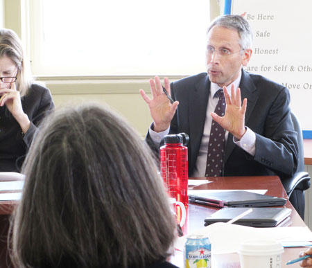 Tom Platt of School Bus Consultants explains the seven options for moving start times at Greenwich public schools at a meeting of the School Start Time Steering Committee last Friday.