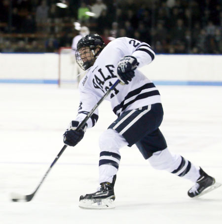Greenwich native John Hayden fires the puck to the net during a game last season with Yale University. The next time Hayden, a former Brunswick School standout, hits the ice with the Bulldogs, he will have a 'C' on his sweater.  (photo courtesy of the Yale University Athletic Department)
