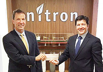 Javier Urrutia, President of Nitron Group presents Greenwich United Way CEO, David Rabin with a check for $30,000.