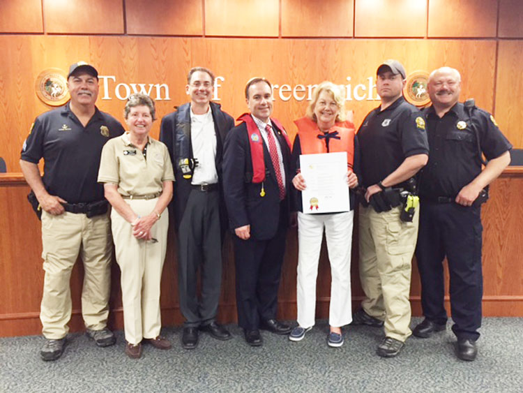 From left: Greenwich Marine Section Sgt. Michael O'Connor Sr., Greenwich Sail & Power Squadron instructors Susan Ryan, Andy Cummings, Greenwich First Selectman Peter Tesei, Nancy York of the Sail & Power Squadron, Greenwich Police Officer Charles Eible and Greenwich Police Marine Section Commander Lt. John Brown. Credit: Barbara Heins.
