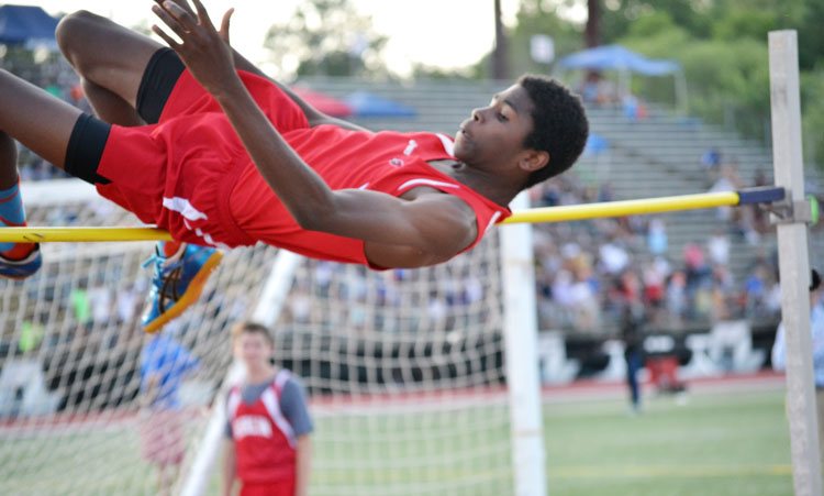 Greenwich's Safir Scott takes to the air during the high jump competition in the CIAC state open meet Monday. (Paul Silverfarb photo)