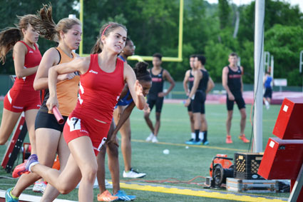 Big Red's Emily Phillippides takes to the track during the 4x400-meter relay race at the CIAC state open finals. (Paul Silverfarb photo)