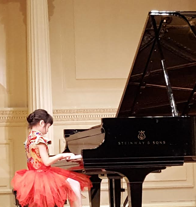 Little Mozart Competition winner, Alessa Rosa, plays piano at Carnegie Hall