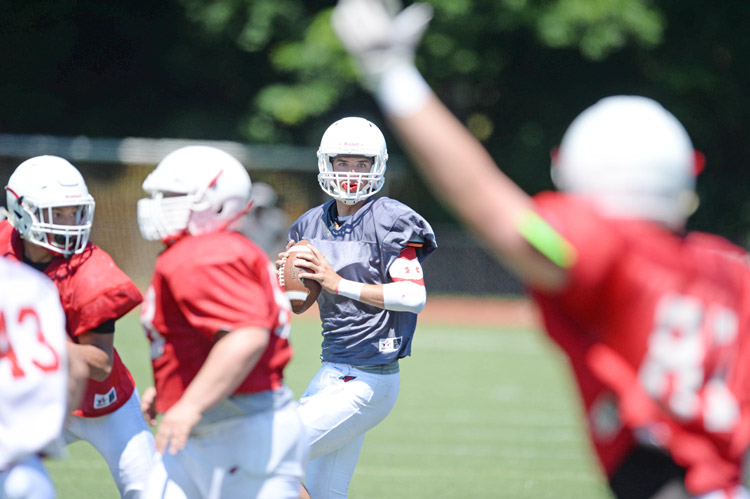 Greenwich High School upcoming senior Connor Langan looks to fire the ball to his wideouts during the annual scrimmage between the GHS Red and GHS White teams Saturday morning. (John Ferris Robben photo)