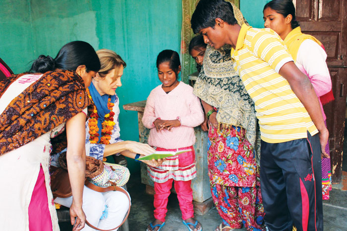 Robin, World Vision Fairfield County, sharing photos with her sponsored child and her family in Agra, India. (contributed photo)