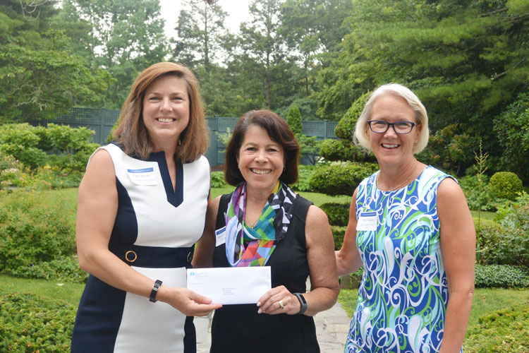 Shari Shapiro, Executive Director of Kids in Crisis, center, receives a check from Carrie Bernier (l) and Amy Wilkinson (r) of The Community Fund of Darien.