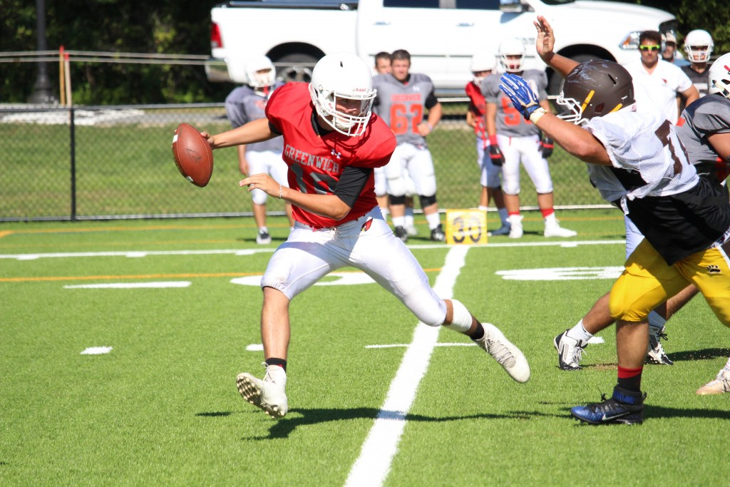 Greenwich High quarterback Connor Langan avoids a defender during Monday's scrimmage (Evan Triantafilidis Photo)