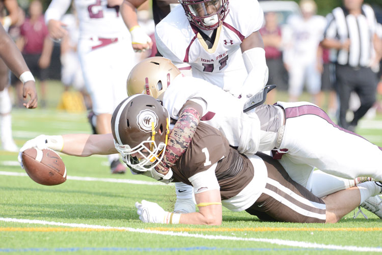 Brunswick School's Sean Morris streches out and finds the end zone during the first quarter of Saturday's game against Iona Prep. (John Ferris Robben photo)