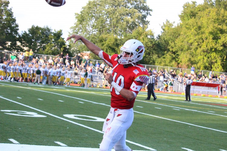 Greenwich's Connor Langan takes practice throws before Saturday's game vs Trinity Catholic