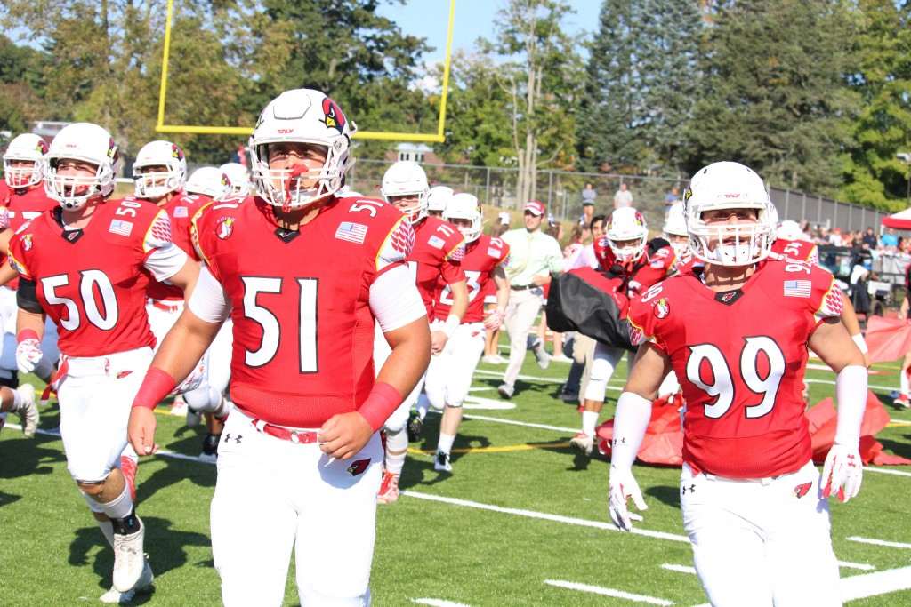 Greenwich's Ben Kraninger and Sam Colandro march out on the field before Saturday's game (Evan Triantafilidis photo)