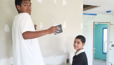 Students drywalling