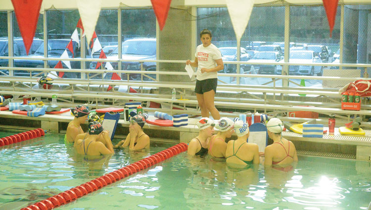The Greenwich High School girl's swimming and diving team gets some instruction from head coach Lorrie Hokayem prior to the start of Tuesday afternoon's practice at the GHS pool. (John Ferris Robben photo)